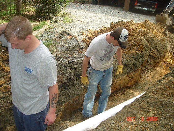 Drain Express's Carrboro sewer line repair team